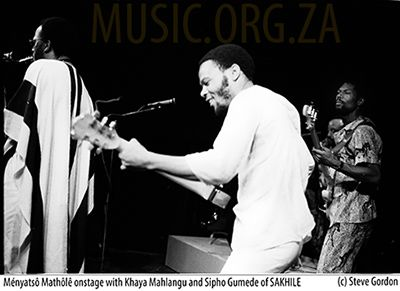 Menyatso onstage with Khaya Mahlangu (L) and Sipho Gumede (R) of Sakhile - © S.Gordon 1987
